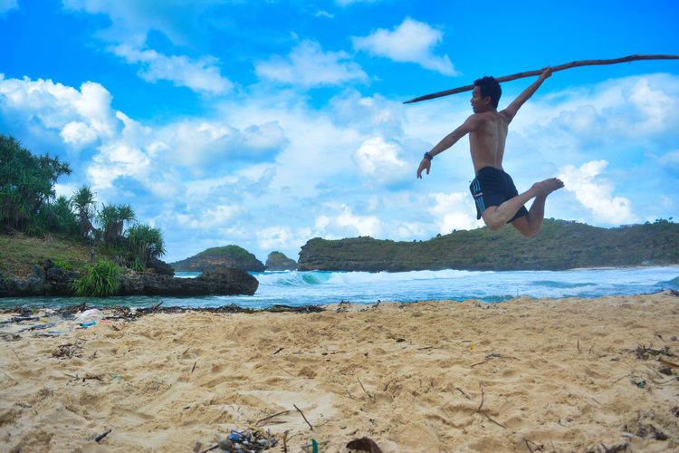 Tour on the Srau Beach. Pacitan, East Java, Indonesia Land Sky Water Mid-air Beach Cloud - Sky One Person Sea Leisure Activity Full Length Real People Jumping Lifestyles Nature Day Beauty In Nature Holiday Sand Vacations Human Arm Outdoors Arms Raised EyeEm Best Shots Beauty In Nature Nature This Is Strength