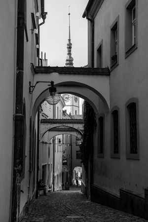 Black And White Black & White Architecture Built Structure Building Exterior The Way Forward Arch City Real People Old Town Old Buildings Cobblestone Cobblestone Streets Oldtown Woman Lady Carrying Carrying Bag