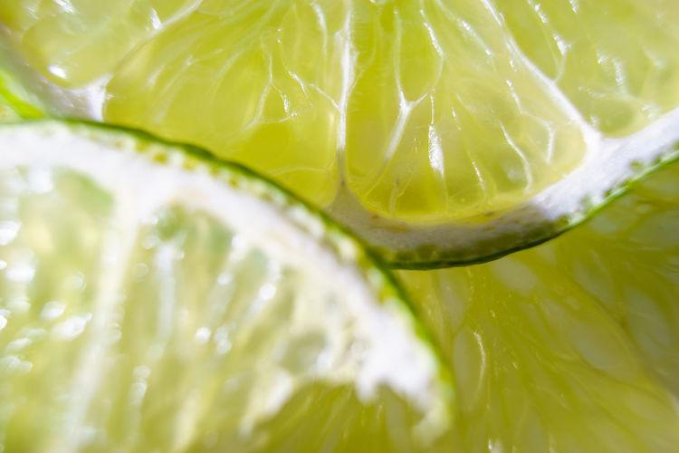 Full frame shot of fresh juicy lemon slice on white background