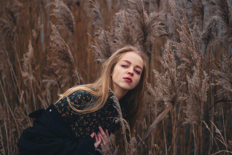 Portrait of beautiful woman standing on land