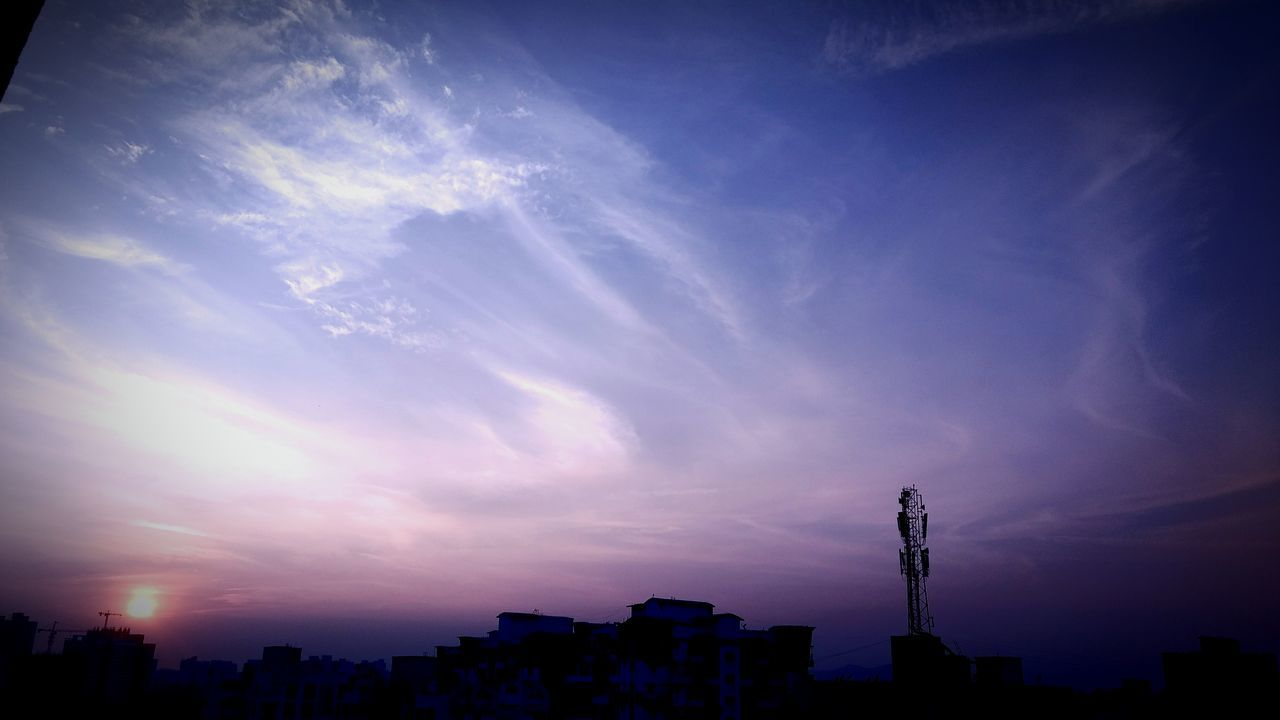 building exterior, architecture, built structure, sky, city, cloud - sky, skyscraper, cityscape, development, sunset, no people, modern, city life, urban skyline, travel destinations, silhouette, blue, outdoors, beauty in nature, nature, day