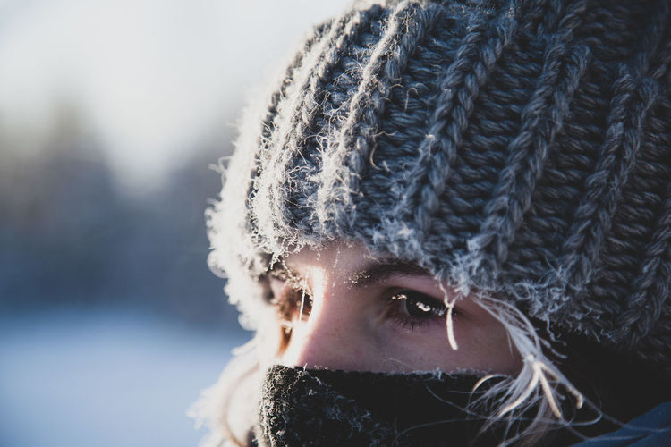 Close-up portrait of woman wearing hat during winter