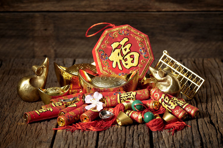 Chinese New Year Lunar New Year Good Luck Decoration Festive Wooden Table Luck Mascot Flat Lay Celebration Craft Firecrackers Ornament Gold China 2020 2019 Pig Minimal Sales Envelope Celebrations Flowers Lucky Tradition Symbol Red Fu Background Festival Spring Holiday Traditional Gold Culture Oriental Fortune Asian  ASIA Packet Plum Blossom Design Celebrate Greeting Prosperity Auspicious Money Happiness Firecracker Ingot Wood - Material Still Life No People Indoors  Gold Colored Food And Drink Art And Craft High Angle View Event Text Food Christmas Container Christmas Ornament