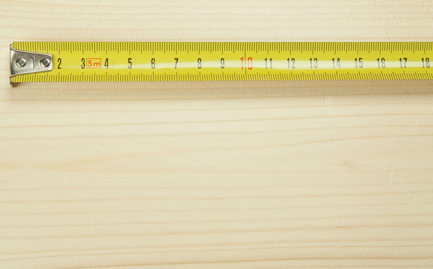 Close-Up Of Measuring Tape On Table