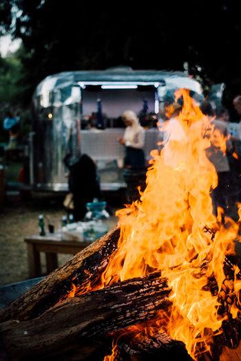 Bonfire Against Motor Home At Park
