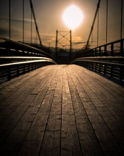 Surface level of footbridge over footpath during sunset