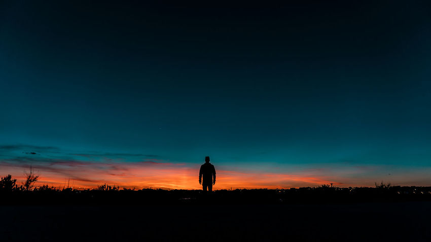 Beauty In Nature Field Idyllic Land Leisure Activity Lifestyles Men Nature Non-urban Scene One Person Orange Color Outdoors Real People Scenics - Nature Silhouette Sky Standing Sunset Tranquil Scene Tranquility The Great Outdoors - 2018 EyeEm Awards The Traveler - 2018 EyeEm Awards