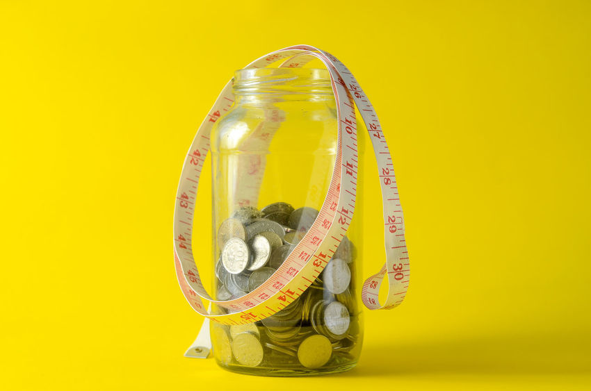 Accuracy Business Close-up Colored Background Copy Space Currency Economy Finance Indoors  Instrument Of Measurement No People Number Rolled Up Single Object Small Group Of Objects Still Life Studio Shot Table Tape Measure Time Yellow Yellow Background
