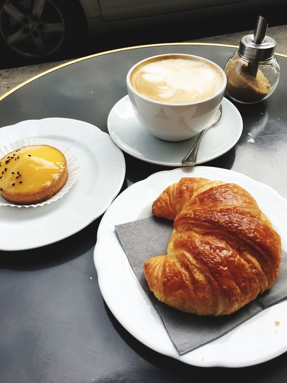 food and drink, croissant, plate, coffee cup, table, coffee - drink, indoors, food, refreshment, breakfast, drink, freshness, high angle view, serving size, no people, close-up, ready-to-eat, sweet food, frothy drink, healthy eating, day