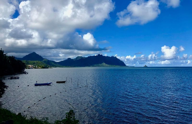 Oahu, Hawaii Boats Sea Cloud - Sky Scenics Water Sky Sea Beauty In Nature Tranquility Tranquil Scene Nature Mountain Outdoors No People Blue Day Nautical Vessel