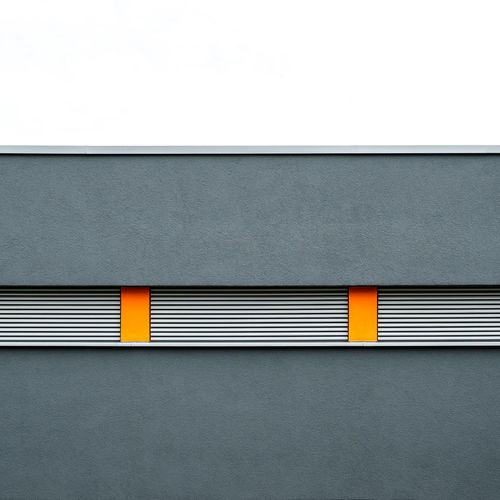 Architecture Gray Built Structure No People Wall - Building Feature Yellow Day Building Exterior Pattern Copy Space Close-up Outdoors Textured  Metal Striped Building Backgrounds Orange Color Window Wall