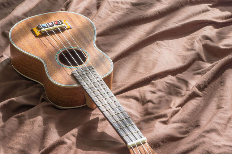 Acoustic Guitar Arts Culture And Entertainment Bed Bedroom Day Furniture Guitar High Angle View Indoors  Linen Music Musical Equipment Musical Instrument Musical Instrument String No People Sheet Still Life String String Instrument Textile
