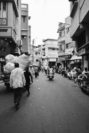 Building Exterior Street Large Group Of People Architecture Transportation Built_Structure Real People City Men Walking City Life Women Road Outdoors Land Vehicle The Way Forward Day Group Of People Motorcycle Awning Let's Go. Together. Adventures In The City Focus On The Story