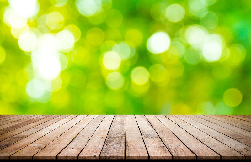 wood desk with green bokeh background for product display Abstract Backgrounds Bench Bright Brightly Lit Clean Close-up Copy Space Defocused Empty Focus On Foreground Grass Green Color Nature No People Outdoors Park Park - Man Made Space Pattern Plant Rain Textured Effect Tree Wood Wood - Material