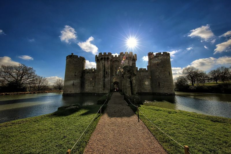 Bodiam Castle Water Architecture Built Structure Grass Building Exterior River Sunlight Sky Sun Footpath Lens Flare Sunny Day Lawn Outdoors Tranquility Tranquil Scene Cloud - Sky History