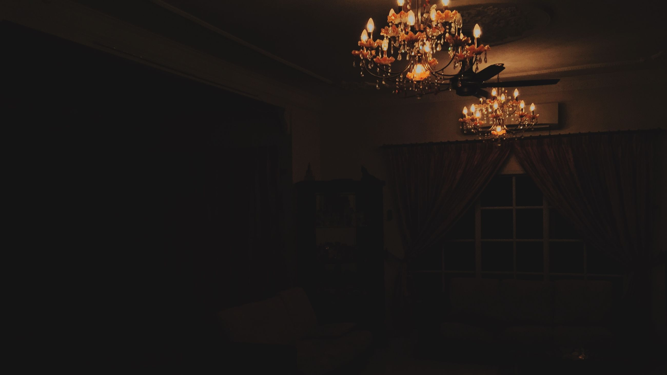 indoors, illuminated, lighting equipment, decoration, chandelier, ceiling, night, hanging, low angle view, home interior, electric lamp, electric light, decor, dark, light - natural phenomenon, electricity, built structure, architecture, no people, glowing