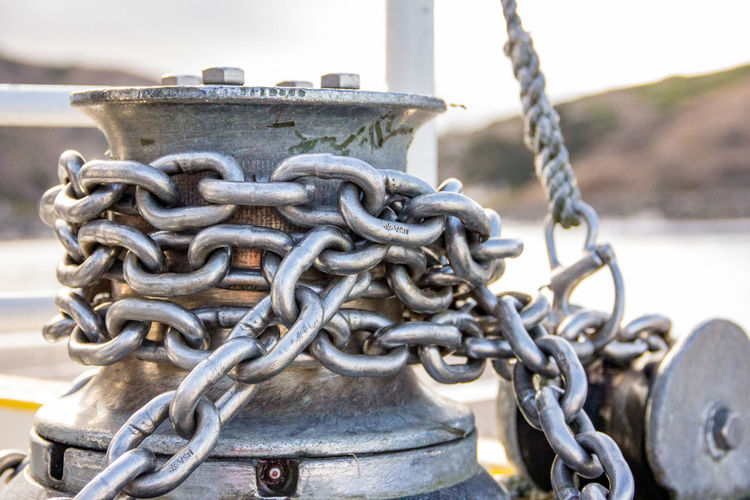 Anchor chain on yacht Madeinusa Nautical Vessel Water Harbor Tied Up Strength Moored Chain Rope Durability Close-up Fishing Equipment Fishing Industry Link Fishing Boat Fishing