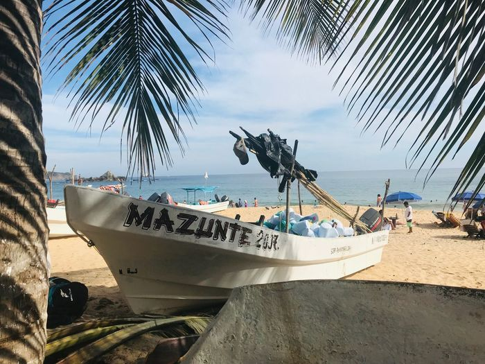Time to relax. Sea Travel Beach Mexico Mazunte Water Beach Sea Transportation Nature Nautical Vessel Sky Sand Sunlight Palm Tree Fishing Boat Tropical Climate Land Day First Eyeem Photo Horizon Over Water