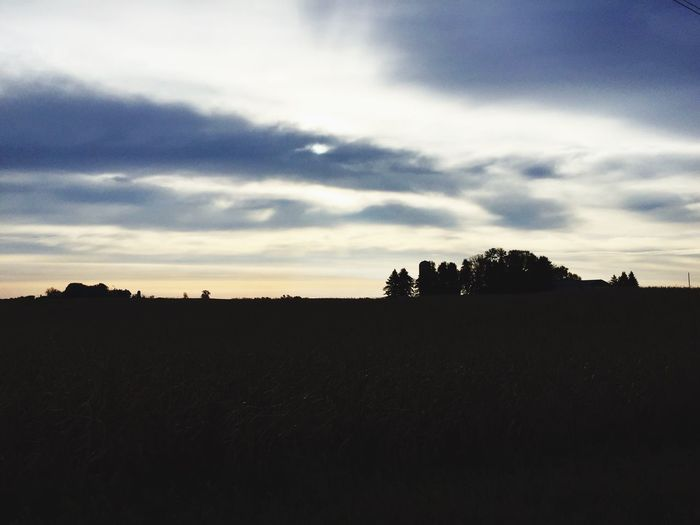 Silhouette Tranquil Scene Tranquility Scenics Sky Beauty In Nature Nature Cloud - Sky Dark Cloud Calm Cloudy Outline Outdoors Non-urban Scene No People Majestic Moody Sky Farmland