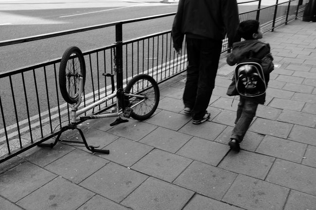 Bike Walking Dad And Son Street Upside Down Black And White Fujifilm X100T Sport In The City Shades Of Grey Capture The Moment B&w Street Photography RePicture Growth Youth Of Today Up Close Street Photography The Street Photographer - 2016 EyeEm Awards