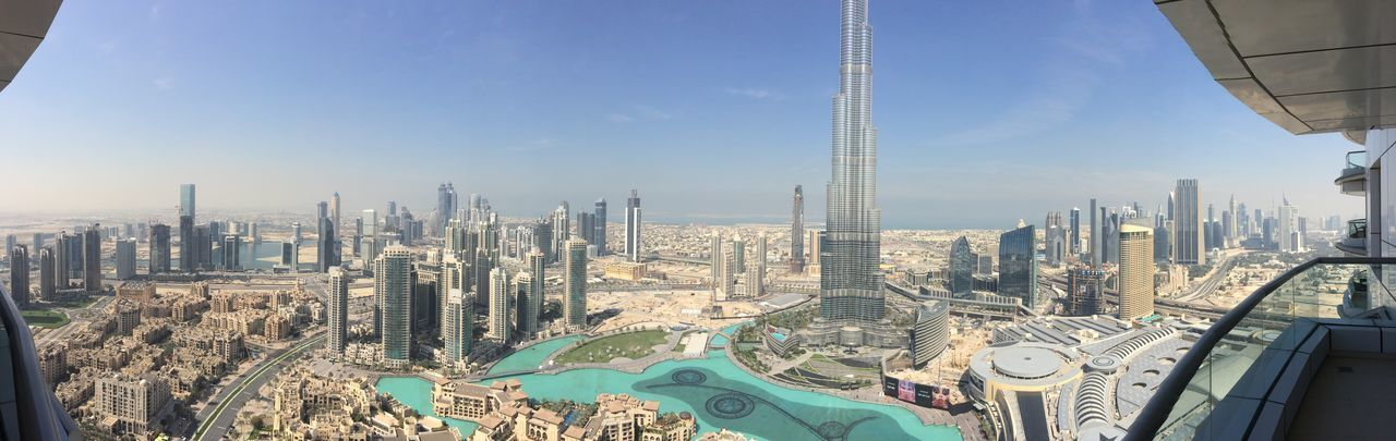 Panoramic view of Burj Khalifa and cityscape seen through balcony