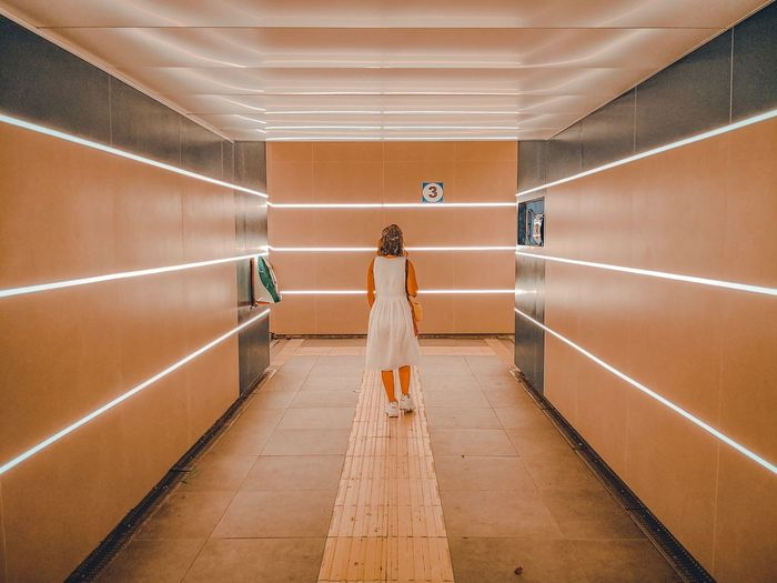 Platform number 3 Italy Girls Travel Happiness Architecture Adult One Person The Way Forward Rear View Full Length The Art Of Street Photography Indoors  Direction Illuminated Real People Arcade Transportation Lighting Equipment Built Structure Women Travel Corridor Diminishing Perspective Flooring Ceiling