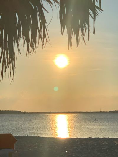 Water Sunset Sky Scenics - Nature Beauty In Nature Sea Tranquility Tranquil Scene Horizon Over Water Sun Reflection Horizon Sunlight Nature Idyllic Beach No People Land Outdoors
