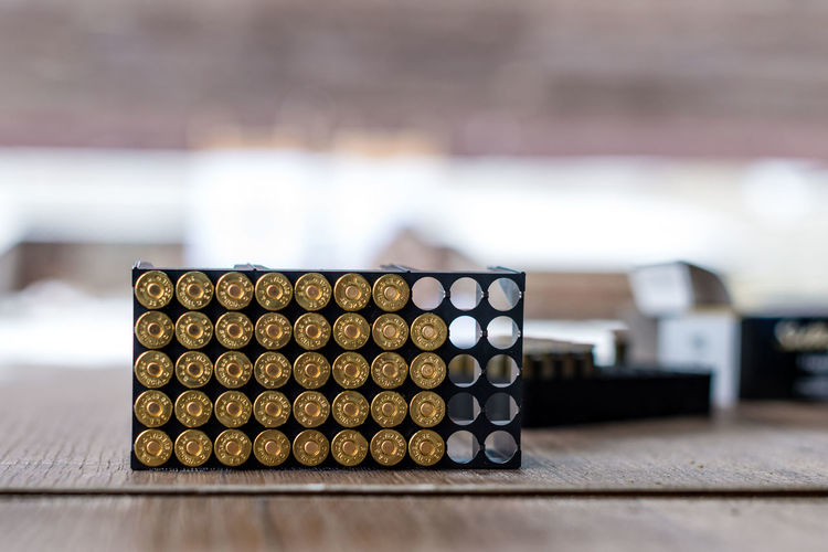 Close-Up Of Ammunitions On Table