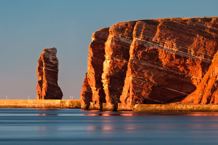 Red cliffs of Heligoland during sundown Helgoland Red Beauty In Nature Clear Sky Cliff Day Eroded Golden Hour Golden Light Idyllic Lange Anna Nature Outdoors Rock Rock Formation Scenics - Nature Sea Sky Solid Stack Rock Sundown Tranquil Scene Tranquility Water Waterfront The Traveler - 2018 EyeEm Awards
