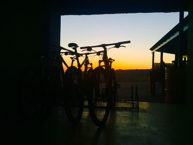 Bicycle Transportation Silhouette Stationary Sunset Land Vehicle Mode Of Transport Sky Outdoors Illuminated Architecture No People Day