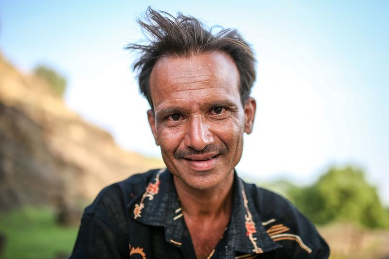 The tourist guide of kailash temple Portrait Headshot Front View Looking At Camera One Person Smiling Adult Real People Casual Clothing Outdoors Day Human Face Men Mid Adult Men