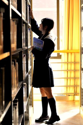looking Shelf Bookshelf Library Looking Searching Young Adult Choice Storage Room Lifestyles One Person Real People Store Adult Indoors  Standing Men People Adults Only Archives