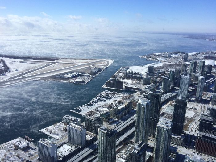 Aerial View Of Billy Bishop Toronto City Airport And City Against Sky