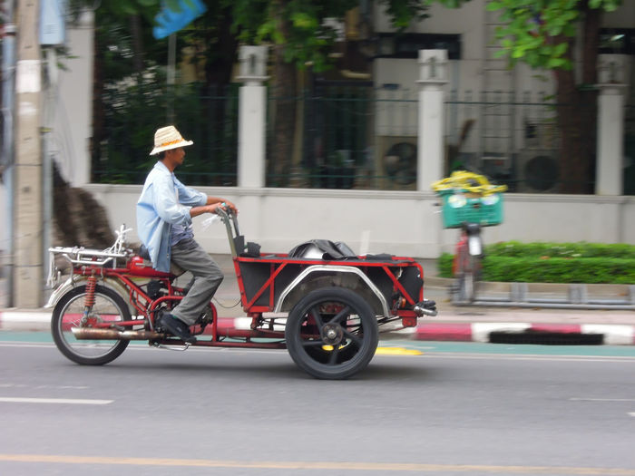 Saleng car on the road Bangkok Box Bikes Cargo Bikes Carrier Cycles City City Life Day Freight Bicycles Freight Tricycles Job Metropolis Outdoors Pan Photography Saleng Saleng Car Thailand Tricycle