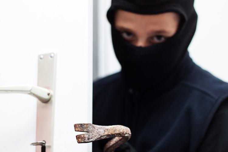 masked burglar breaking the door with crowbar Breaking Crime Crowbar Security Stealing Balaclava Burglar Criminal Door Gangster House Mask Masked Rob Robber Safety Thief