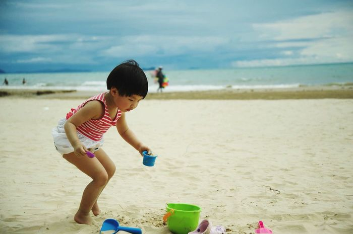 Childhood Sand Real People Vacations Sand Pail And Shovel Outdoors