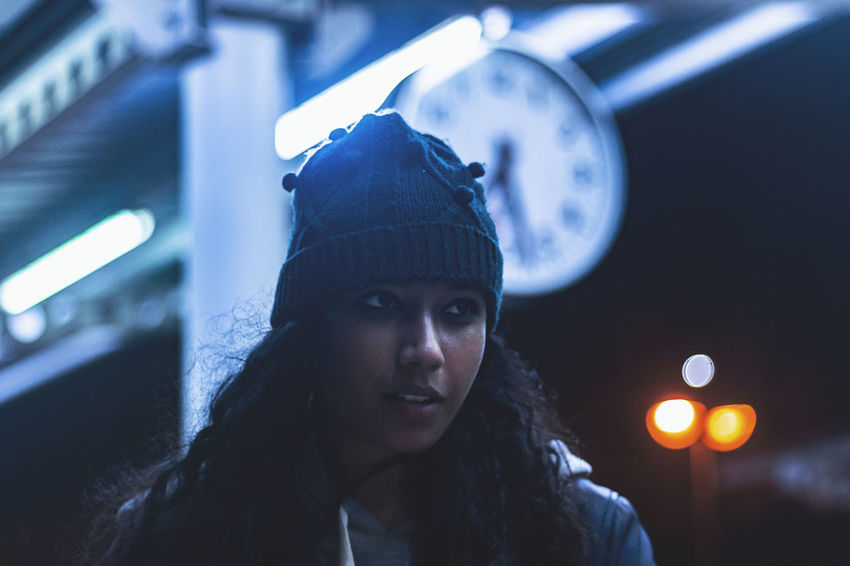 Portrait Headshot Illuminated One Person Front View Focus On Foreground Night Looking At Camera Lifestyles Young Adult Real People Hat Clothing Leisure Activity Young Women Lighting Equipment Knit Hat Indoors  Hairstyle Warm Clothing Clock