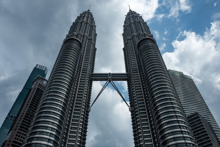 Kuala Lumpur Built Structure Architecture Sky Tall - High Building Exterior Cloud - Sky Office Building Exterior Skyscraper City Tower Travel Destinations Modern Low Angle View Tourism Nature No People Building Travel Outdoors Financial District  Spire  Petronas Twin Towers