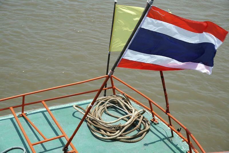 High angle view of flag on sea