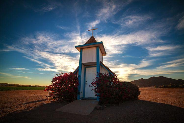 Chapel On Field Against Sky