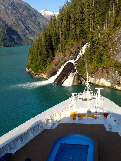 View Of Scenic Waterfall From Ship Entering Fjord