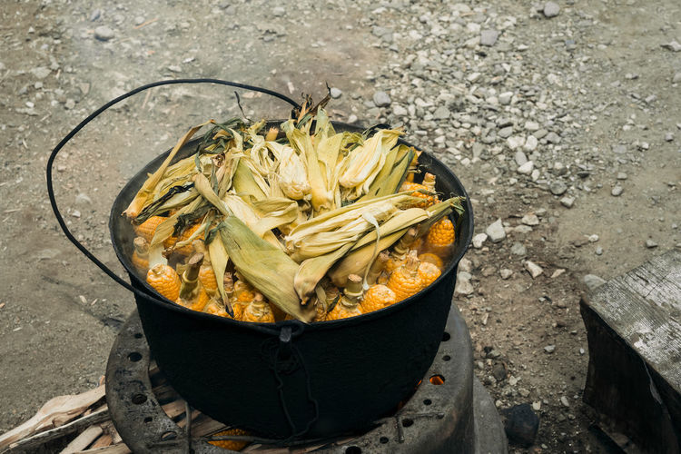 High Angle View Of Corns In Container Cooking On Stove