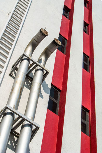 Low angle view of pipe on building