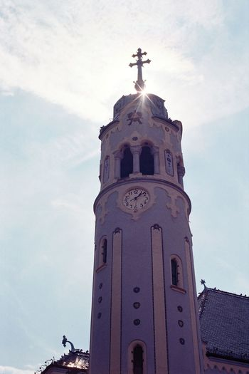 Analogue Photography Bratislava, Slovakia Church Film Architecture Blue Church Building Exterior Built Structure Clock Cloud - Sky Cross Day Film Photography Flair Low Angle View No People Outdoors Place Of Worship Religion Sky Spirituality St Elisabeth Travel Destinations