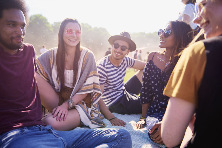 Friends Group Of People Festival Summer Sunset Sunlight Siting Real People Fun Enjoying The Sun Summer Festival Concert Afro Indian Woman Caucasian Blanket Talking Good Times Party Event