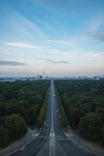 Street amidst tiergarten against sky