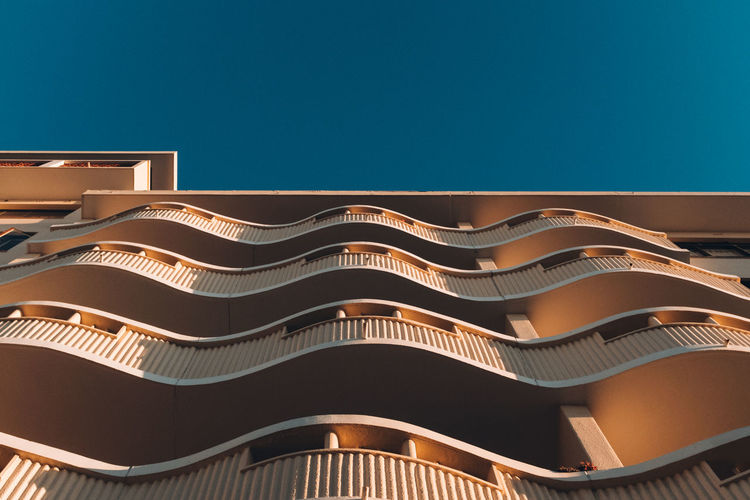 Wavy Wavy Architecture Blue Building Building Exterior Built Structure City Clear Sky Copy Space Day Design Low Angle View Modern Nature No People Outdoors Pattern Sky Sunlight Window