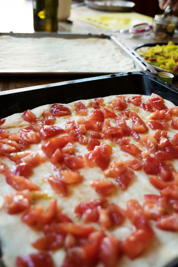 preparing at home pizza with fresh tomatoes Cherry Raw Tray Baking Baking Tray Dough Pizza Pizza Maker Preparing Tomatoes