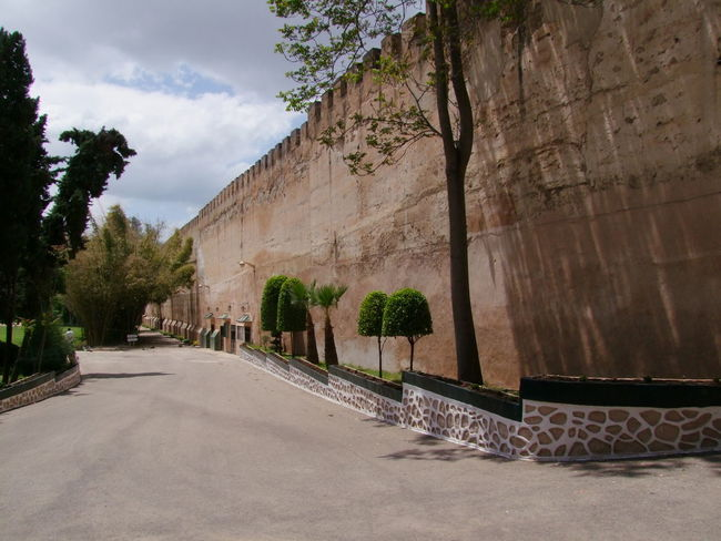 City Walls surrounding Meknes Golf Club Architecture City City Walls Cloudy Sky Composition Distant Perspective Famous Place Full Frame Golf Club Historical Wall Meknès Moroccan Architecture Moroccan Style Morocco No People Outdoor Photography Sunlight And Shadow The Way Forward Tourist Attraction  Tourist Destination Tranquil Scene Tree Walkway