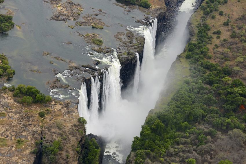 Arial Shot National Park Victoria Falls Africa Zimbabwe Zambesi River Zambia Zimbabwe Arial Arial Photography Arial View Arialview Beauty In Nature Border Force Nature No People Outdoors Power In Nature River Splashing Victoria Falls Victoria Falls In Zambia, Africa View From Helicopter Water Waterfall Zambesi